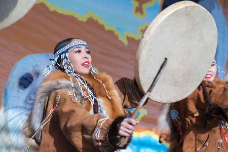 Female dancing with tambourine in national clothing indigenous inhabitants Kamchatka. Concert, celebration Koryak national holiday Hololo - Day of Seal. Kamchatka Peninsula, Russia - Nov 4, 2018 에디토리얼