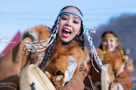 Female dancing with tambourine in national clothing indigenous inhabitants Kamchatka. Concert, celebration Koryak national holiday Day of Seal - Hololo. Kamchatka Peninsula, Russia - November 4, 2018