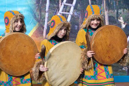 Girls dancing with tambourine in national clothing indigenous inhabitants Kamchatka. Concert, celebration Koryak national ritual holiday Hololo - Day of Seal. Kamchatka Peninsula, Russia - Nov 4, 2018