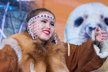 Female expression dancing in national clothing indigenous inhabitants Kamchatka Peninsula. Concert, celebration Koryak national holiday Day of Seal - Hololo. Kamchatka Territory, Russia - Nov 4, 2018.