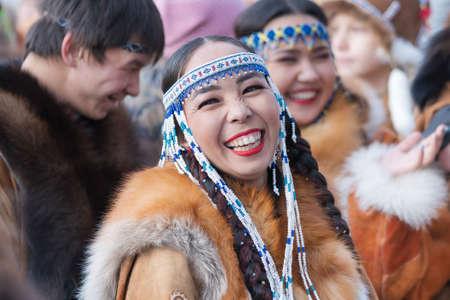 Portrait expression smiling woman in traditional clothing indigenous inhabitants of Kamchatka. Celebration Koryak national ritual holiday Hololo Day of Seal. Kamchatka Region, Russia - Nov 4, 2018.