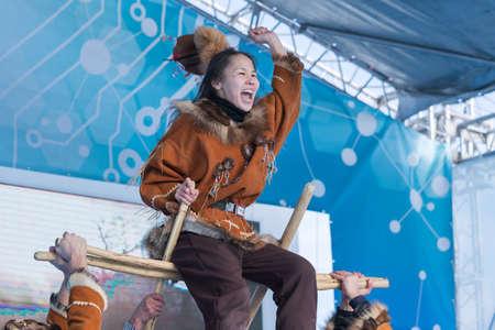 Aborigine female emotional dancing in national clothes indigenous people Kamchatka. Concert of State Academic Koryak National Dance Ensemble Mengo. Kamchatka Peninsula, Russian Far East - Feb 21, 2019