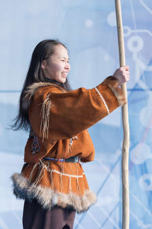 Aboriginal female emotion dancing with spear in national clothes indigenous people. Concert of Kamchatka State Academic Koryak National Dance Ensemble Mengo. Kamchatka Peninsula, Russia - Feb 21, 2019 에디토리얼