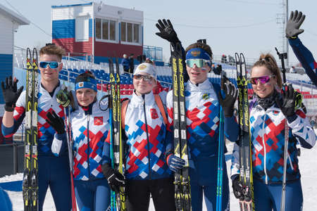 Saint Petersburg biathletes at finish after skiing and rifle shooting. Junior biathlon competitions East of Cup. Petropavlovsk-Kamchatsky City, Kamchatka Peninsula, Russian Far East - April 14, 2019