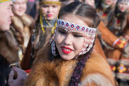 Portrait cute smiling young woman in traditional clothing aboriginal people Kamchatka Peninsula. Celebration Koryak national holiday Hololo Day of Seal. Kamchatka Peninsula, Russia - Nov 4, 2018 에디토리얼