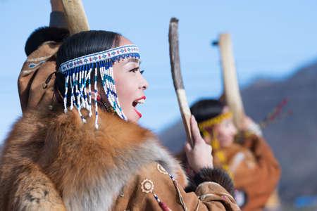 Woman dancing with tambourine in tradition clothing aboriginal people Kamchatka Peninsula. Concert celebration Koryak national ritual holiday Hololo - Day of Seal. Kamchatka, Russia - November 4, 2018