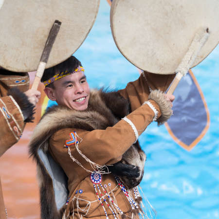 Man expression dancing with tambourine in tradition clothing aborigine people Kamchatka. Concert, celebration Koryak national holiday Hololo Day of Seal. Kamchatka Region, Russia - November 4, 2018