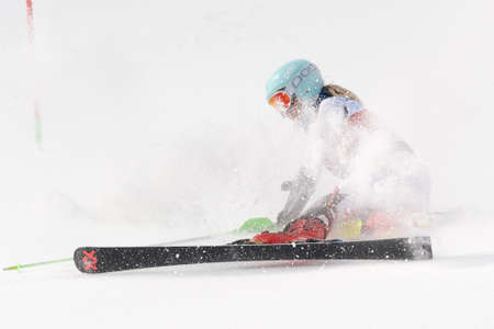 Russian Alpine Skiing Cup, International Ski Federation Championship, slalom. Mountain skier Elesina Elizaveta Sverdlovsk skiing down mount. Moroznaya Mount, Kamchatka Peninsula, Russia - Mar 29, 2019