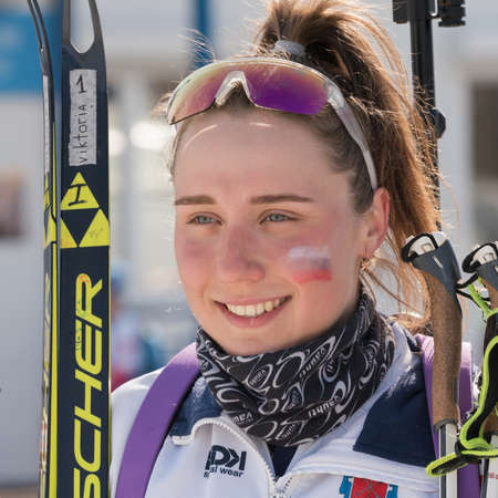 Portrait of smiling Russian sportswoman biathlete Victoria Petrova Saint Petersburg at finish after rifle shooting and skiing. Junior biathlon competitions East Cup. Kamchatka, Russia - April 14, 2019