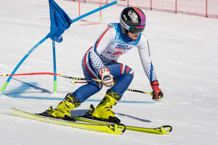 Sportswoman mountain skier Vakhnina Anna Krasnoyarsk skiing down mountain slope parallel slalom. Russian Federation Alpine Skiing Championship. Kamchatka Peninsula, Russian Far East - March 31, 2019.
