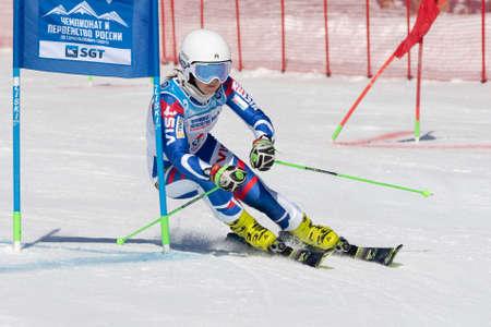 Russian Federation Alpine Skiing Championship, parallel slalom. Sportswoman mountain skier Shustrova Darya Saint Petersburg skiing down mountain slope. Kamchatka Peninsula, Russia - March 31, 2019.