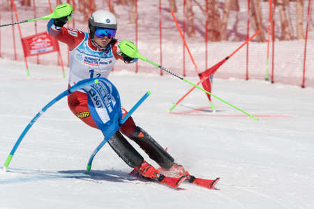 Russian Federation Alpine Skiing Championship, parallel slalom. Sportsman mountain skier Alekhin Nikita Kamchatka skiing down mountain slope. Kamchatka Peninsula, Russian Far East - March 31, 2019.