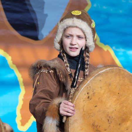 Female child dancing with tambourine in tradition clothing aborigine people Kamchatka. Concert, celebration Koryak national holiday Hololo Day of Seal. Kamchatka Territory, Russia - Nov 4, 2018