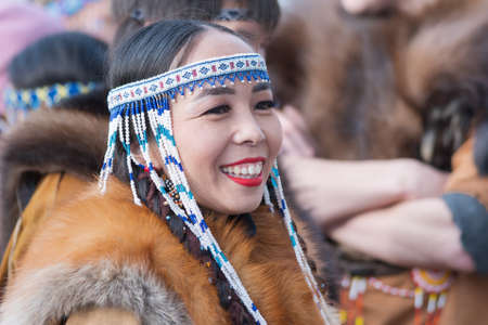 Portrait smiling expression female in traditional clothing aborigine people Kamchatka Peninsula. Celebration Koryak national ritual holiday Hololo Day of Seal. Kamchatka, Russia - November 4, 2018