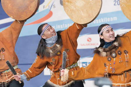 Group aborigine dancer in traditional clothes native people dancing with tambourine. Concert Koryak Dance Ensemble Mengo during Russian Alpine Skiing Championship. Kamchatka, Russia - April 2, 2019 에디토리얼