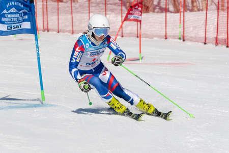 Sportswoman mountain skier Shustrova Darya Saint Petersburg skiing down mountain slope parallel slalom. Russian Federation Alpine Skiing Championship. Kamchatka, Russian Far East - March 31, 2019.