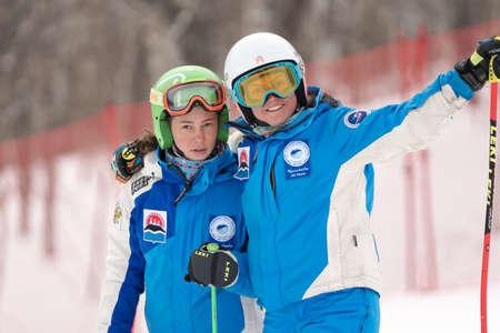Portrait of two mountain skiers Kamchatka Ski Team during Russian Women Alpine Skiing Cup, International Ski Federation Championship, giant slalom. Kamchatka Peninsula, Russian Far East - Apr 2, 2019.