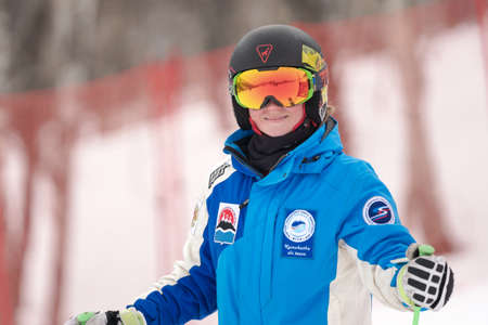 Portrait of mountain skier Lendya Ulyana during Russian Women Alpine Skiing Cup, International Ski Federation Championship, giant slalom. Kamchatka Peninsula, Russian Far East - April 2, 2019.