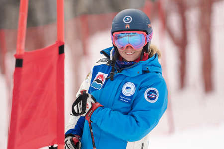 Portrait smiling mountain skier Kristina Kryukova during Russian Women Alpine Skiing Cup, International Ski Federation Championship, giant slalom. Kamchatka Peninsula, Russian Far East - April 2, 2019