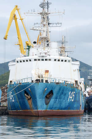 Russian warship Coast Guard of Border Guard Service of Russian FSB anchored at pier in seaport of Petropavlovsk-Kamchatsky City. Pacific Ocean, Kamchatka Peninsula, Russian Far East - 5 Sep, 2018