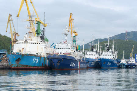 Group of warships Coast Guard of Border Guard Service of Russian FSB anchored at pier in Petropavlovsk-Kamchatsky sea port. Pacific Ocean, Kamchatka Peninsula, Russian Far East - 5 September, 2018.