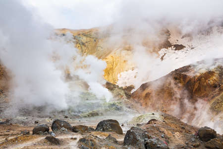 Volcanic landscape, crater of active volcano: hot spring, fumarole, lava field, gas-steam activity. Dramatic mountain landscape, popular travel destinations for active vacation, hiking, mount climbing