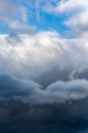 Scenery dramatic thunderstorm clouds with blue sky background. Natural weather landscape Фото со стока