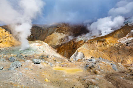 Beautiful volcanic landscape, crater of active volcano: hot spring, fumarole, lava field, gas-steam activity. Mountain landscape, travel destinations for active vacation, hiking and mount climbing Фото со стока