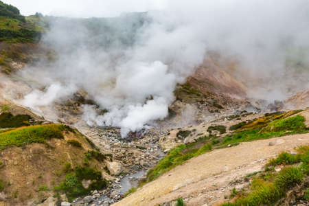 Breathtaking scenery view of volcanic landscape, aggressive hot spring, eruption fumarole, gas-steam activity in crater of active volcano. Stunning mountain landscape, travel destinations for hiking.