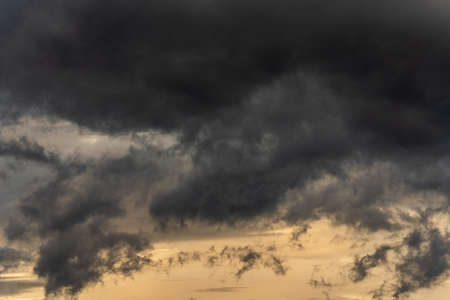 Dramatic stormy clouds in sky during rainy weather.