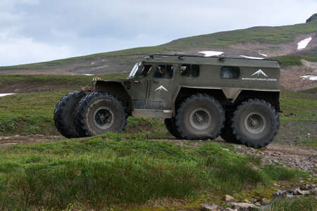 Snow swamp off-road and all-terrain vehicle Predator for transporting tourists and travelers in most difficult, harsh conditions driving on mount road. Kamchatka Peninsula, Russia - August 16, 2019