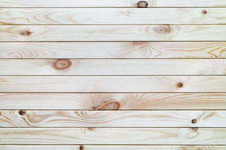 Surface wooden plank light brown background with horizontal boards. Flat lay close-up view
