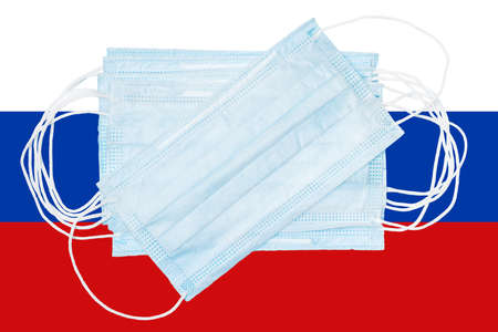 Group protective medical surgical face masks on background colors flag of Russia or Russian national flag. Concept of disease in country and global world, quarantine, pandemic outbreak and 2019-ncov