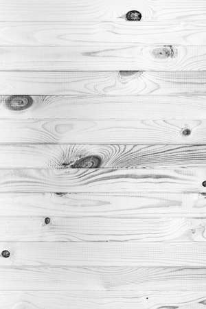 Surface natural wooden plank black and white background. Flat lay, close-up view of vintage monochrome photography, textured effect.