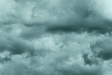 Dramatic storm clouds in rainy weather in sky, coloring in trend Tidewater Green color of year 2021. Meteorology abstract texture, nature background. Toned image, soft focus and motion blur cloudscape