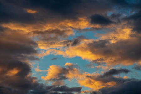 Dramatic clouds rising of sun floating in blue sky to change summer weather. Soft focus, motion blur amazing meteorology cloudscape background.