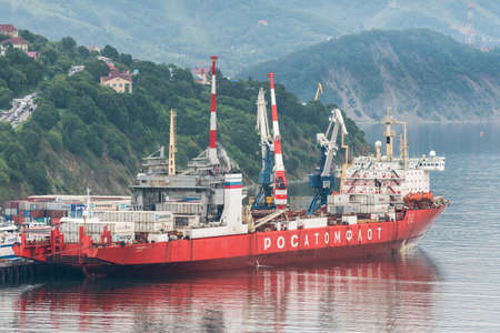 Russian cargo container ship nuclear-powered icebreaker Sevmorput Corporation FSUE Atomflot or Rosatomflot. Container terminal commercial sea port. Pacific Ocean, Kamchatka, Russia - August 27, 2019