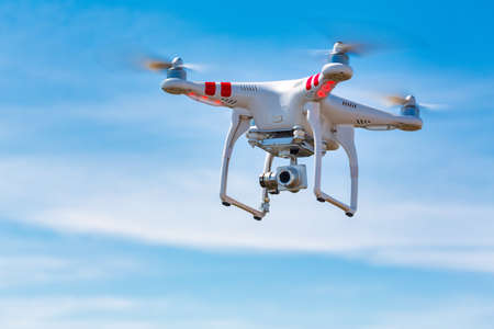 Flying quadcopter drone UAV with digital camera in blue sky, takes aerial pictures world around from birds eye view. Kamchatka Peninsula, Russian Federation - June 18, 2017 Redactioneel