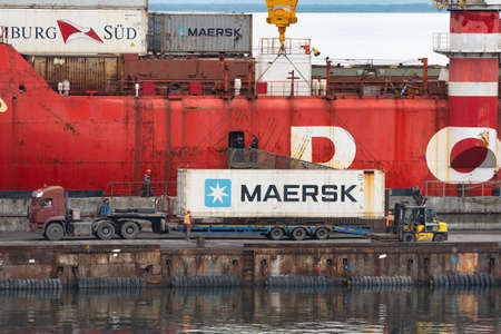 Crane unloading container cargo ship Sevmorput Rosatomflot - Russian nuclear powered icebreaker lighter aboard ship carrier. Terminal commercial sea port. Kamchatka Peninsula, Russia - August 27, 2019 Redactioneel