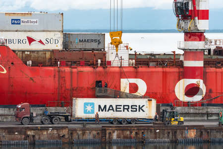 Crane unloading container cargo ship Sevmorput Corporation Atomflot - Russian nuclear powered icebreaker lighter aboard ship carrier. Terminal commercial seaport. Kamchatka, Russia - August 27, 2019. Redactioneel