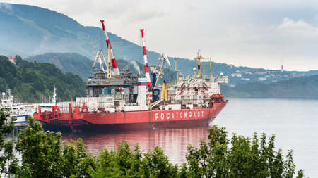 Russian cargo container ship nuclear-powered icebreaker Sevmorput Corporation FSUE Atomflot or Rosatomflot. Container terminal commercial seaport. Pacific Ocean, Kamchatka, Russia - August 27, 2019