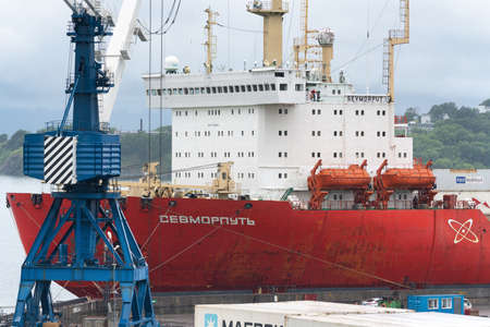 Russian cargo container ship nuclear-powered icebreaker Sevmorput Corporation FSUE Atomflot or Rosatomflot. Container terminal commercial seaport. Kamchatka, Pacific Ocean, Russia - August 27, 2019. Redactioneel