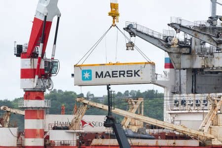 Crane unloads container ship Sevmorput - Russian nuclear-powered icebreaker lighter aboard ship carrier. Container terminal sea port. Pacific Ocean, Kamchatka Peninsula, Russia - August 26, 2019 Redactioneel