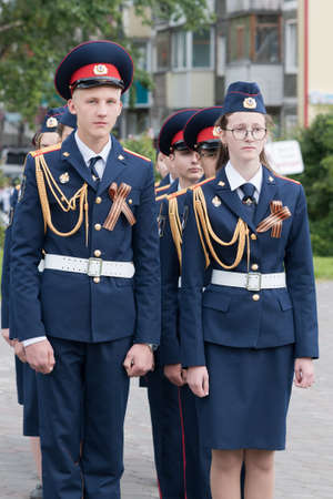 Cadets in uniform of Cadet Class of Investigative Committee of Russia during solemn event dedicated to 75th anniversary of completion Kuril Islands Landing Operation. Kamchatka, Russia - Sep 2, 2020 Redactioneel