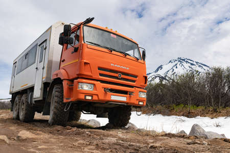 Russian off-road passenger expedition truck KamAZ on mountain road
