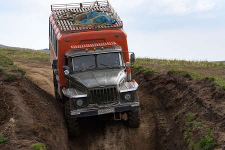 Russian off-road extreme expedition truck Ural driving on mountain road