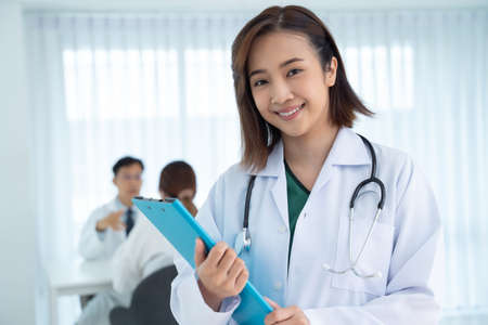 An Asian female doctor smiled friendly while working in the hospital. Concepts of health care, plastic surgery, beauty care