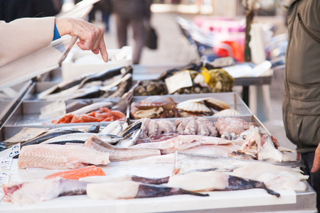 Order many fresh seafood at market in venice photo