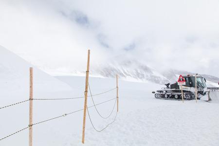 Wheel loader machine unloading snow , Jungfrau,interlaken, Switzerland