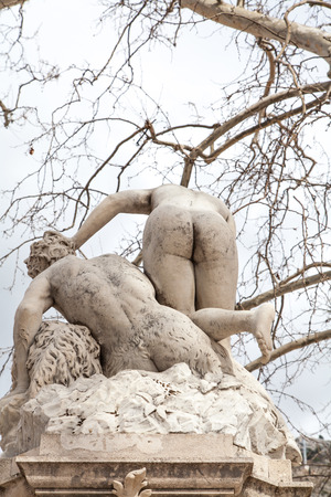 nude statue at dubrovnik with gray sky photo
